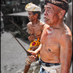 In the aboriginal Balinese villages of The Bali Aga, ancient human blood sacrifice rituals are performed. These Holy Men and bringing their Kris (Holy dagger) to be blessed.