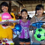 Happy girls receive art supplies, schools supplies, clothes, toys and more at a recent Floating Leaf charity event