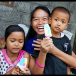 Handing out ice cream and smiles at a recent community outreach event sponsored by Floating Leaf