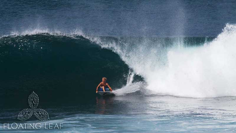 Surfer in wave at Bali beach
